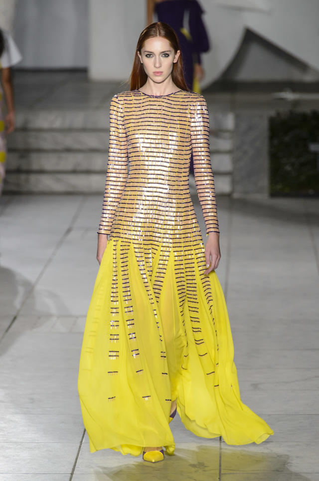 <p><i>A model wears a long-sleeved yellow embellished dress from the SS18 Carolina Herrera collection. (Photo: ImaxTree) </i></p>
