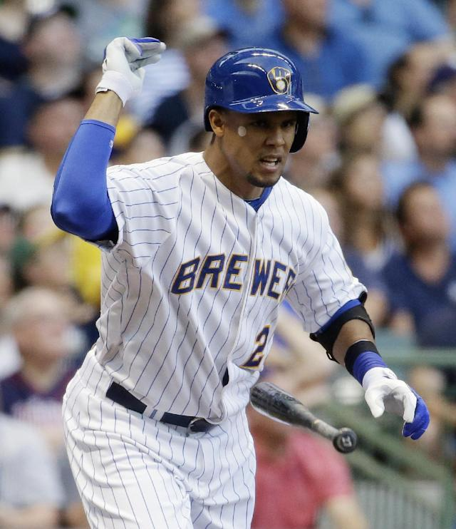 Milwaukee Brewers' Carlos Gomez reacts after flying out during the first inning of a baseball game against the Minnesota Twins on Tuesday, June 3, 2014, in Milwaukee. (AP Photo/Morry Gash)