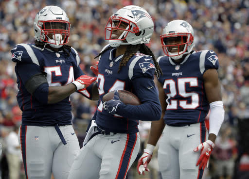 New England Patriots defensive back Stephon Gilmore, center, celebrates his interception with Dont'a Hightower, left, and Eric Rowe, right, during the first half of an NFL football game against the Houston Texans, Sunday, Sept. 9, 2018, in Foxborough, Mass. (AP Photo/Steven Senne)