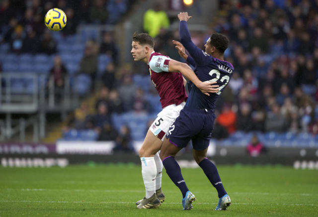 Burnley's James Tarkowski, left and West Ham United's Sebastien Haller battle for the ball during the English Premier League soccer match between Burnley and West Ham United, at Turf Moor, in Burnley, England, Saturday, Nov. 9, 2019. (Ian Hodgson/PA via AP)
