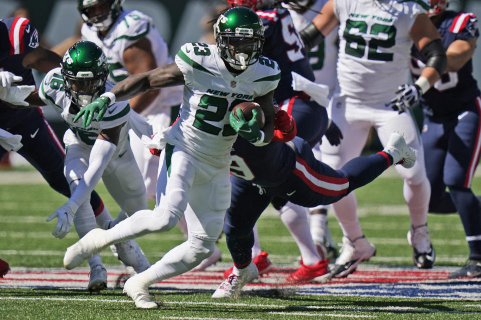 New York Jets' Tevin Coleman (23) runs the ball during the first half of an NFL football game against the New England Patriots, Sunday, Sept. 19, 2021, in East Rutherford, N.J. (AP Photo/Frank Franklin II)
