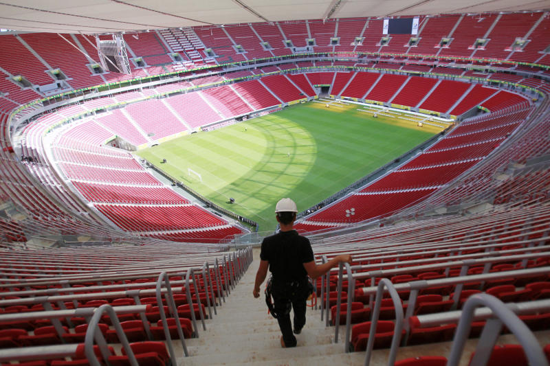 A worker walks the stairs of the National Stadium ahead of the Confederations Cup in Brasilia, Brazil, Wednesday, June 12, 2013. The Confederations Cup will start on June 15. (AP Photo/Eugene Hoshiko)