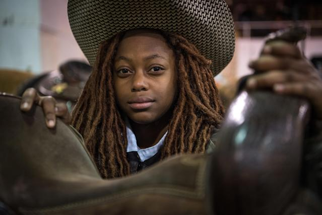 <p>ReRe, a young cowgirl poses for a portrait at the Black Heritage Rodeo in Greenville, Miss., January 2018. (Photograph by Rory Doyle) </p>