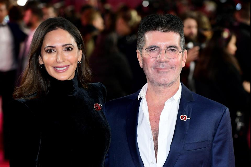 <p>Simon Cowell with his partner Lauren Silverman</p> (PA)