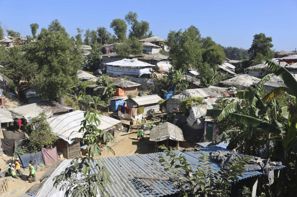 An aerial view of huts at a refugee camp from where Rohingya refugees were moved to an island called 'Bhasan Char' in Balukhali, Bangladesh, Monday, Dec. 28, 2020. Officials in Bangladesh sent a second group of Rohingya refugees to an isolated island in the Bay of Bengal on Monday, despite calls by human rights groups for a halt to the process. More than 30 buses carrying about 1,500 refugees left their camps in Cox's Bazar district on the way to the island, a government official involved with the process said. (AP Photo/Shafiqur Rahman)