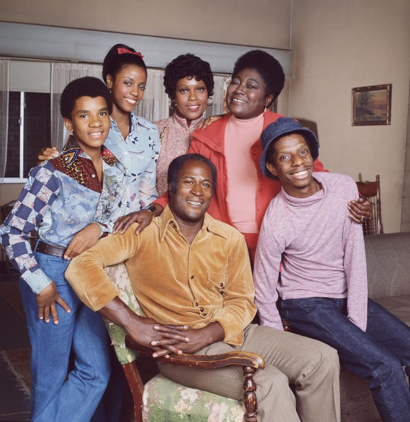 """The """"Good Times"""" cast, shown in 1977, included, in front, John Amos, left, and Jimmie Walker, and in the back row from left, Ralph Carter, Bern Nadette Stanis, Ja'net DuBois and Esther Rolle. (CBS Photo Archive via Getty Images)"""