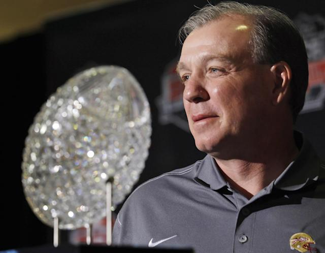 Florida State head coach Jimbo Fisher poses with The Coaches' Trophy during a news conference for the BCS National Championship NCAA college football game Tuesday, Jan. 7, 2014, in Newport Beach, Calif. Florida State beat Auburn 34-31 to win the championship the night before. (AP Photo/Morry Gash)