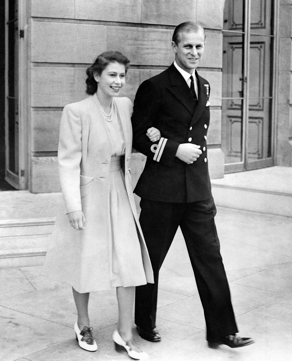 <p>A uniformed Philip stepped out with his brand new fiancée, Princess Elizabeth at Buckingham Palace in July 1947. Photo: Getty Images.</p>