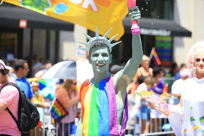 A marcher dressed as a the Statue of Liberty gestures for the camera during the N.Y.C. Pride Parade in New York on June 30, 2019. (Photo: Gordon Donovan/Yahoo News)