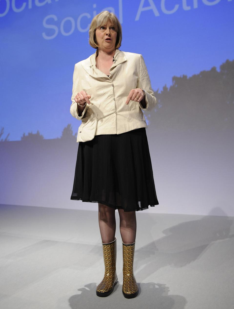 Theresa May, then Shadow Leader of House of Commons, addressed the Conservative Party conference in Blackpool wearing wellington boots, and was clearly very proud of them. Photo dated 20/09/2007 (PA)