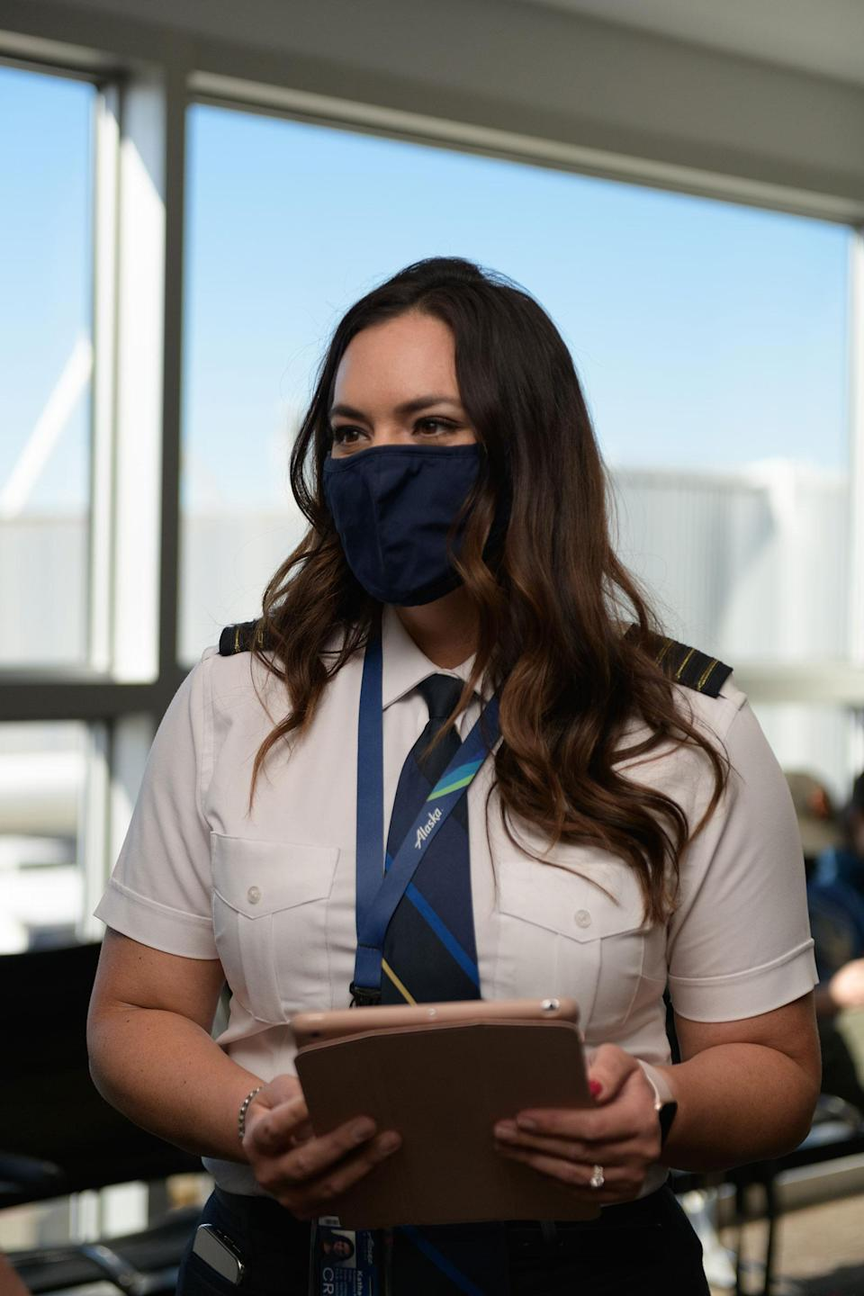 """Alaska Airlines Captain Kat Pullis with the iPad containing the kind of data pilots once had to cart around in heavy suitcases filled with paper.<span class=""""copyright"""">Chona Kasinger for TIME</span>"""