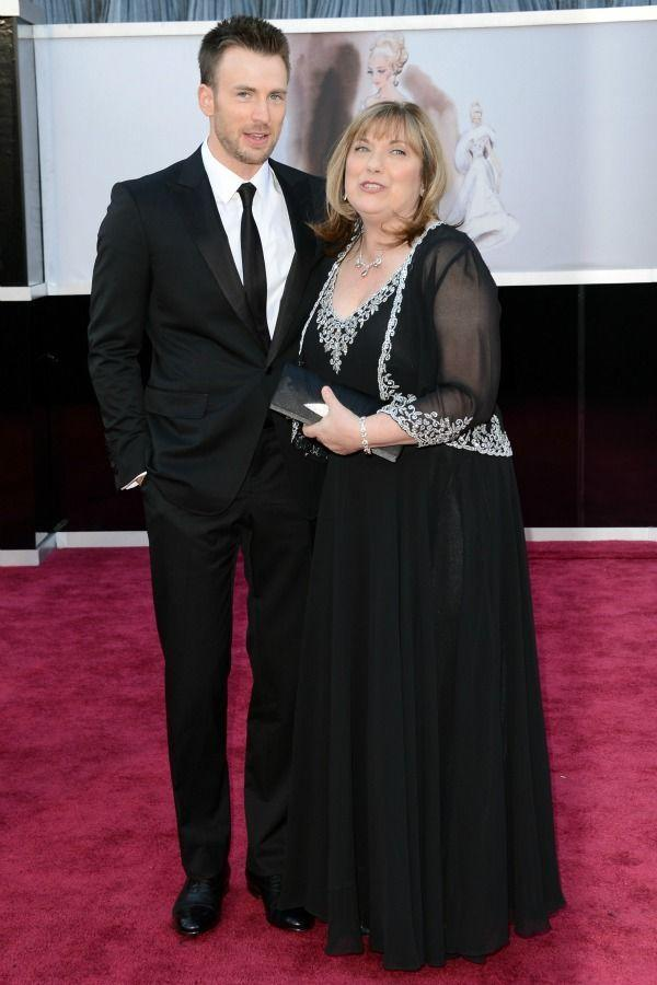 <p>Chris treated his mom, Lisa, to a night with the stars at the 2013 Academy Awards.</p>