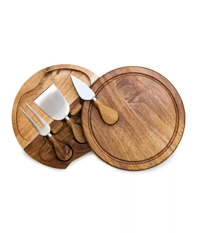 "<p>Anyone would be excited to take this <a href=""https://www.macys.com/shop/product/toscana-by-picnic-time-acacia-brie-cheese-cutting-board-tools-set?ID=6836943&amp;pla_country=US&amp;CAGPSPN=pla&amp;cm_mmc=Google_SH_PLA_Tabletop-_-GS_Dinnerware_PLA_Picnic_Time-_-293719128459-_-pg1050696845_c_kclickid__kenshoo_clickid__KID_EMPTY_1546922795_61770741747_293719128459_pla-515693596755_99967406031USA__c_KID_&amp;trackingid=509x1050696845&amp;m_sc=sem&amp;m_sb=Google&amp;m_tp=PLA&amp;m_ac=Google_SH_PLA_Tabletop&amp;m_ag=PicnicTime&amp;m_cn=GS_Dinnerware_PLA&amp;m_pi=go_cmp-1546922795_adg-61770741747_ad-293719128459_pla-515693596755_dev-c_ext-_prd-99967406031USA&amp;gclid=CjwKCAiAsOmABhAwEiwAEBR0Zh8Z1NpDiJB_Gu0P8pLZz1rb0iEXEYNMDHHv_b63InlWtYzAi1XNRRoC_88QAvD_BwE"" class=""link rapid-noclick-resp"" rel=""nofollow noopener"" target=""_blank"" data-ylk=""slk:Picnic Time  Toscana by Acacia Brie Cheese Cutting Board &amp; Tools Set"">Picnic Time<br> Toscana by Acacia Brie Cheese Cutting Board &amp; Tools Set</a> ($20, originally $35) out.</p>"