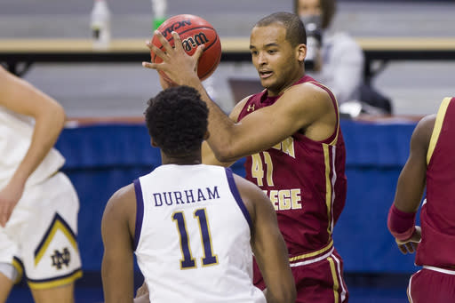 Boston College's Steffon Mitchell (41) turns downcourt after grabbing a rebound next to Notre Dame's Juwan Durham (11) during the second half of an NCAA college basketball game Saturday, Jan. 16, 2021, in South Bend, Ind. (AP Photo/Robert Franklin)