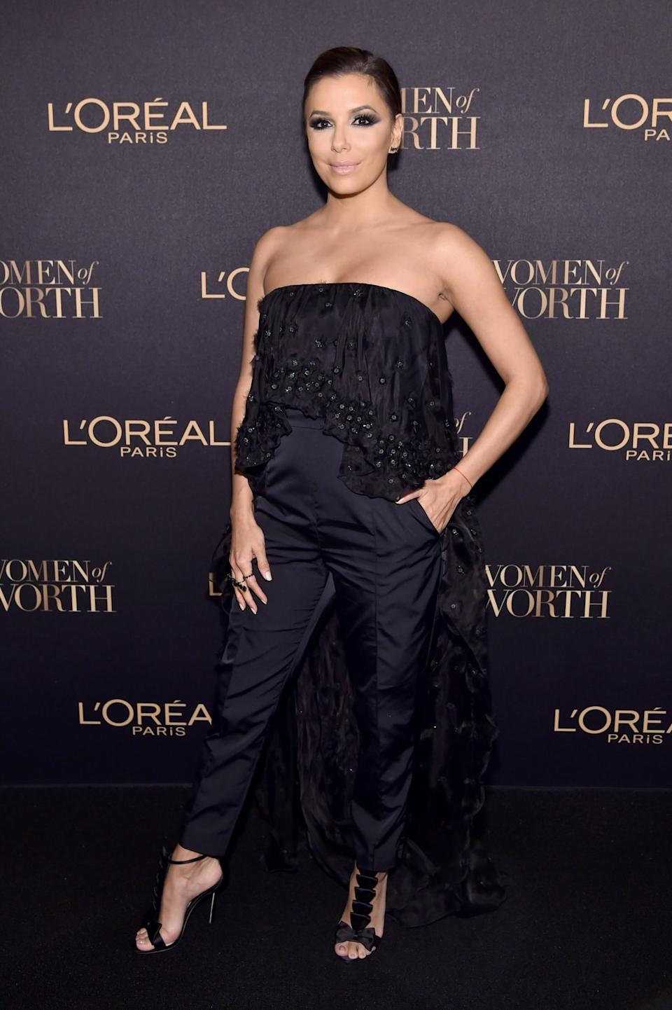 <p>Eva Longoria wore a caped midnight blue jumpsuit by Noon by Noor. <i>[Photo: Getty]</i> </p>