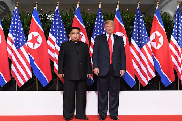 <p>US President Donald Trump (R) poses with North Korea's leader Kim Jong Un (L) at the start of their historic US-North Korea summit, at the Capella Hotel on Sentosa island in Singapore on June 12, 2018. – Donald Trump and Kim Jong Un have become on June 12 the first sitting US and North Korean leaders to meet, shake hands and negotiate to end a decades-old nuclear stand-off. (Photo: Saul Loeb/AFP/Getty Images) </p>