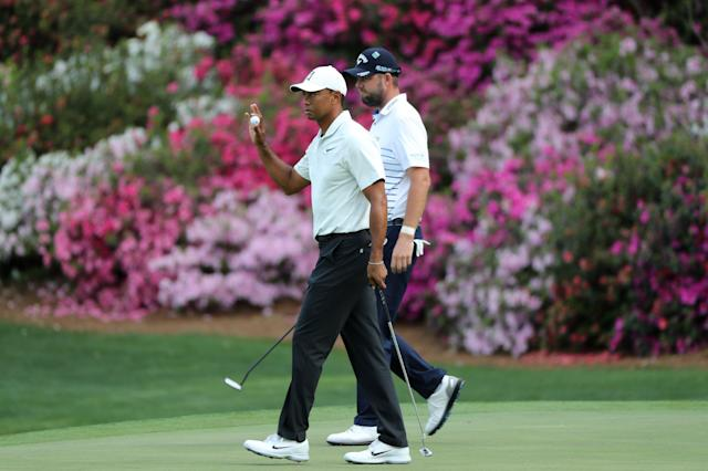 U.S. golfer Tiger Woods (L) and Marc Leishman of Australia walk off the 13th after both birdied the hole during second round play of the 2018 Masters golf tournament at the Augusta National Golf Club in Augusta, Georgia, U.S., April 6, 2018. REUTERS/Lucy Nicholson