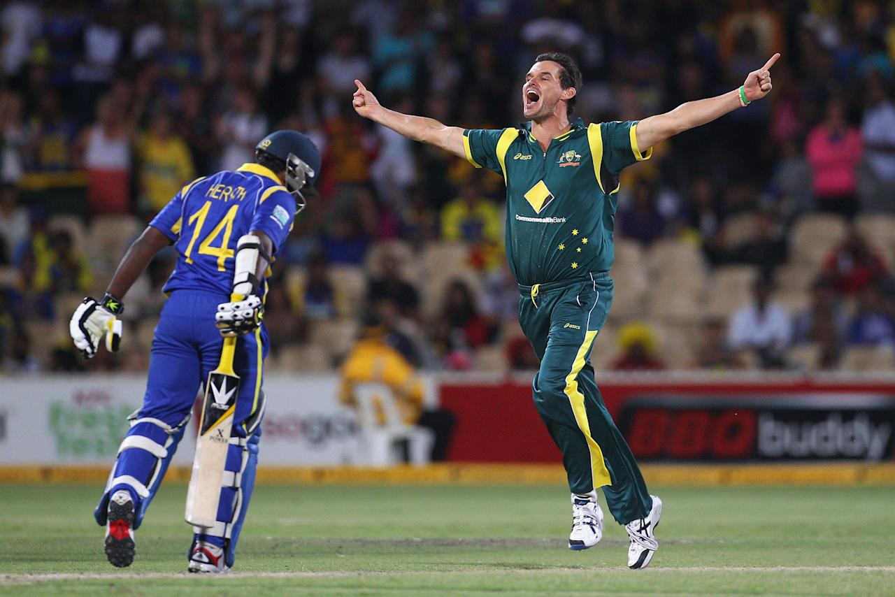 ADELAIDE, AUSTRALIA - MARCH 08:  Clint McKay of Australia celebrates taking the wicket of Rangana Herath of Sri Lanka during the third One Day International Final series match between Australia and Sri Lanka at Adelaide Oval on March 8, 2012 in Adelaide, Australia.  (Photo by Cameron Spencer/Getty Images)