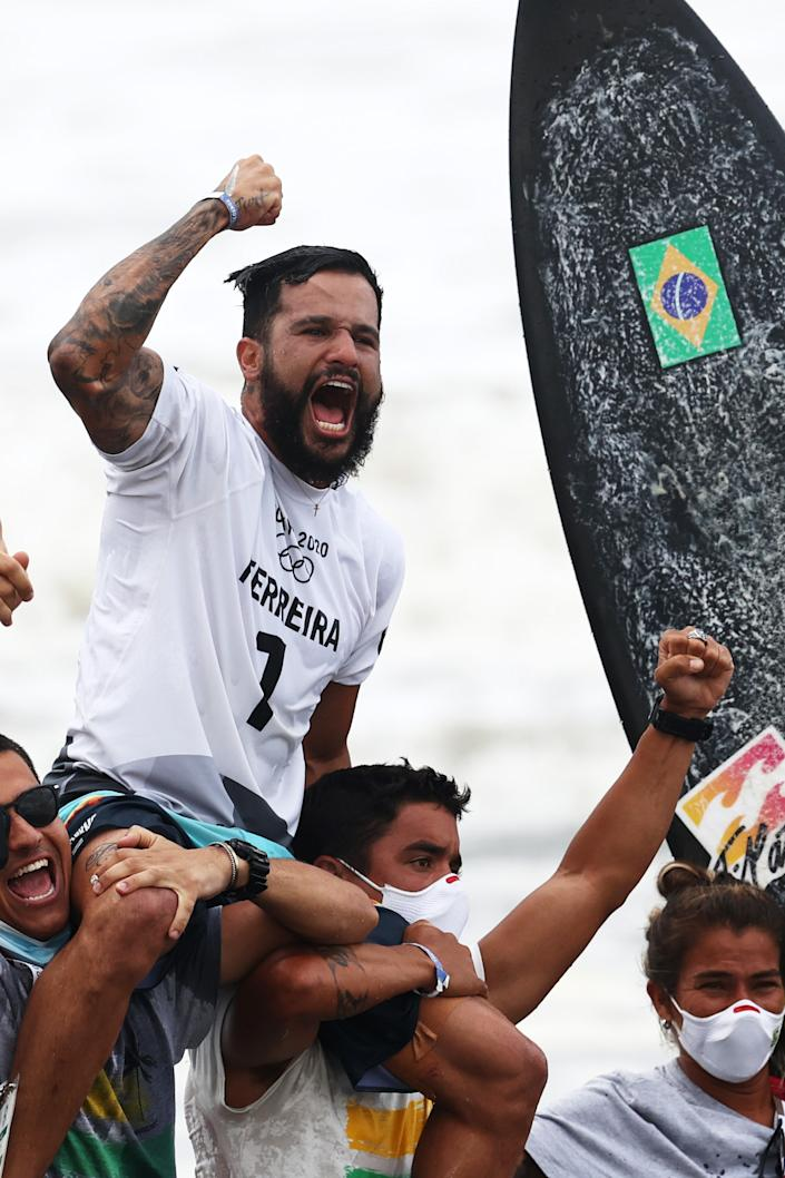 <p>ICHINOMIYA, JAPAN - JULY 27: Italo Ferreira of Team Brazil shows emotion as he is chaired off the beach after winning the Gold Medal in the men's Surfing final match against Kanoa Igarashi of Team Japan on day four of the Tokyo 2020 Olympic Games at Tsurigasaki Surfing Beach on July 27, 2021 in Ichinomiya, Chiba, Japan. (Photo by Ryan Pierse/Getty Images)</p>