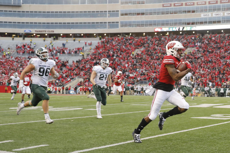 Wisconsin wide receiver Kendric Pryor (3) outruns Michigan State defensive end Jacub Panasiuk (96) and linebacker Chase Kline (21) for a reception touchdown during the second half of an NCAA college football game Saturday, Oct. 12, 2019, in Madison, Wis. Wisconsin won 38-0. (AP Photo/Andy Manis)
