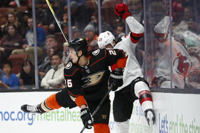 Anaheim Ducks' Brandon Montour, front, avoids a check from New Jersey Devils' Blake Coleman during the first period of an NHL hockey game Sunday, March 18, 2018, in Anaheim, Calif. (AP Photo/Jae C. Hong)