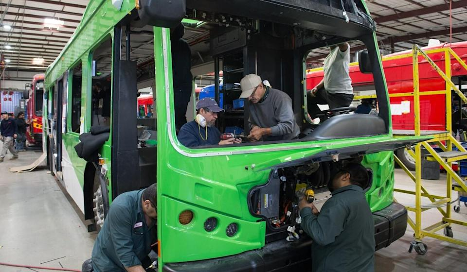 Workers at the BYD bus assembly workshop in Lancaster, California. Photo: Xinhua