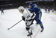 Los Angeles Kings' Blake Lizotte (46) is checked by Vancouver Canucks' Quinn Hughes (43) during the first period of an NHL hockey game Wednesday, Oct. 9, 2019, in Vancouver, British Columbia. (Darryl Dyck/The Canadian Press via AP)