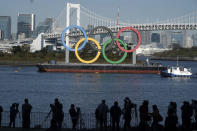FILE - In this Dec. 1, 2020, file photo, the Olympic Symbol is reinstalled after it was taken down for maintenance ahead of the postponed Tokyo 2020 Olympics, in the Odaiba section in Tokyo. (AP Photo/Eugene Hoshiko, File)