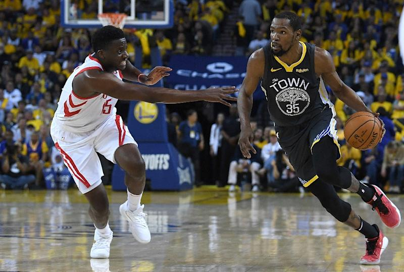 9c038625fd41 Golden State  39 s Kevin Durant drives on Houston  39 s Clint