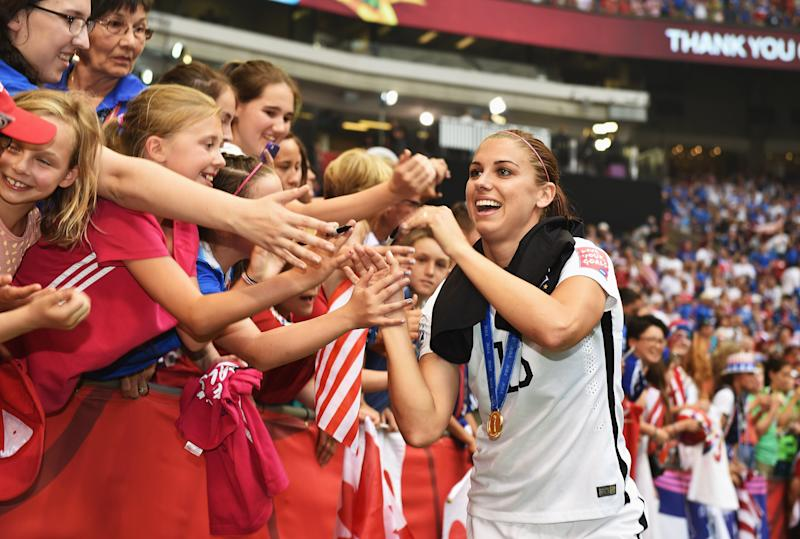 Alex Morgan led the line for both the 2015 and 2019 World Cup champion USWNTs. Which was better? (Photo by Stuart Franklin - FIFA/FIFA via Getty Images)