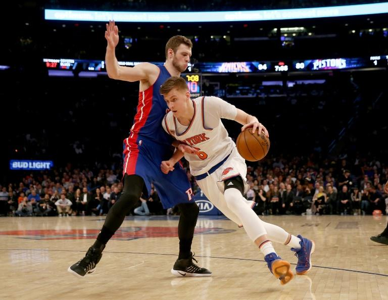 Kristaps Porzingis of the New York Knicks heads for the net as Jon Leuer of the Detroit Pistons defends, at Madison Square Garden in New York, on March 27, 2017