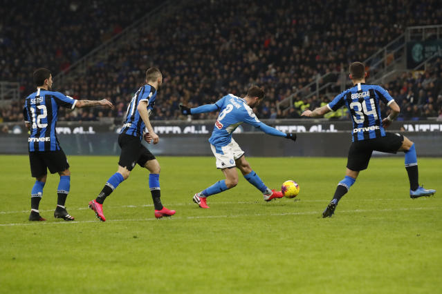 Napoli's Fabian Ruiz scores the opening goal during an Italian Cup soccer match between Inter Milan and Napoli at the San Siro stadium, in Milan, Italy, Wednesday, Feb. 12, 2020. (AP Photo/Antonio Calanni)
