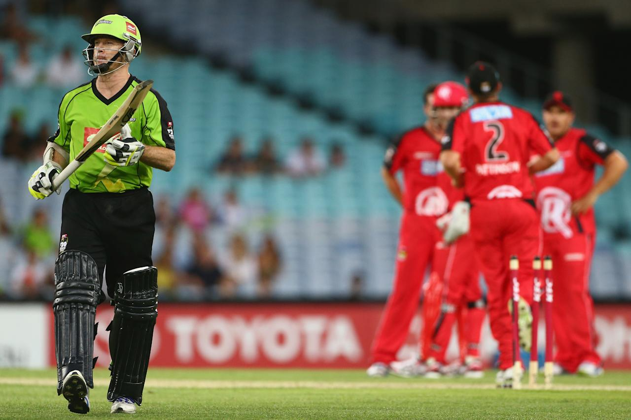 SYDNEY, AUSTRALIA - DECEMBER 14:  Chris Rogers of the Thunder leaves the field after being dismissed during the Big Bash League match between the Sydney Thunder and the Melbourne Renegades at ANZ Stadium on December 14, 2012 in Sydney, Australia.  (Photo by Mark Kolbe/Getty Images)
