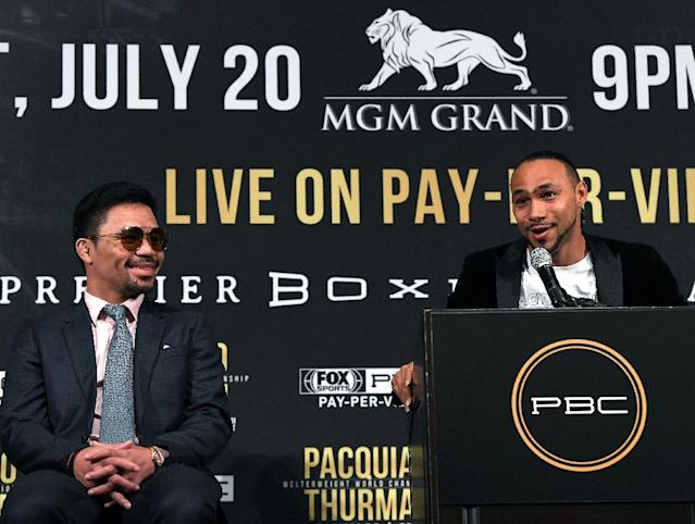 Keith Thurman speaks next to Manny Pacquiao during a press conference ahead of their WBA Welterweight Championship fight (AFP Photo/Harry How)