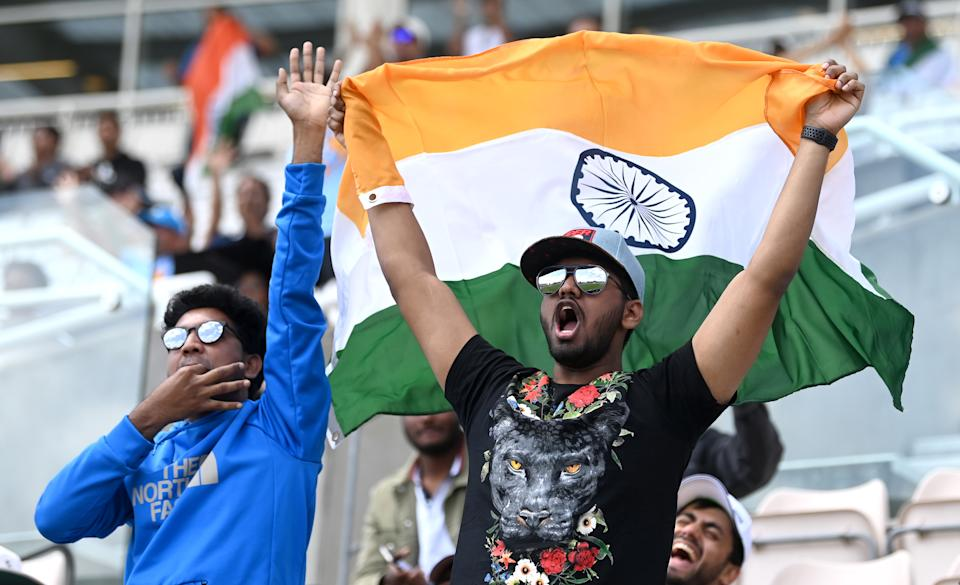 SOUTHAMPTON, ENGLAND - JUNE 23: Indian fans cheer on their team during Day 6 of the ICC World Test Championship Final between India and New Zealand at The Ageas Bowl on June 23, 2021 in Southampton, England. (Photo by Gareth Copley-ICC/ICC via Getty Images)