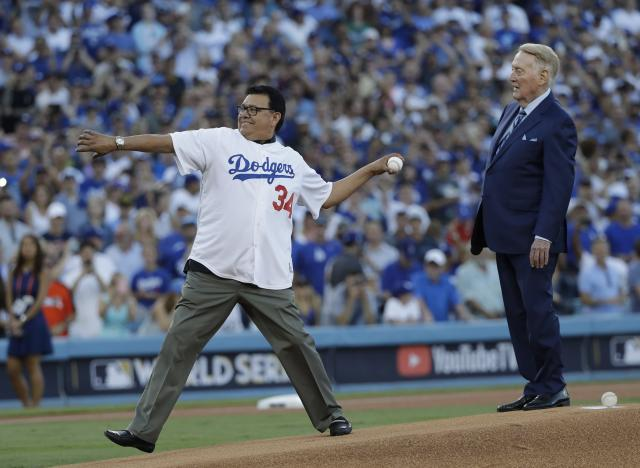 <p>Vin Scully and Fernando Valenzuela throw out the ceremonial first pitch before Game 2 of baseball's World Series between the Houston Astros and the Los Angeles Dodgers Wednesday, Oct. 25, 2017, in Los Angeles. (AP Photo/David J. Phillip) </p>