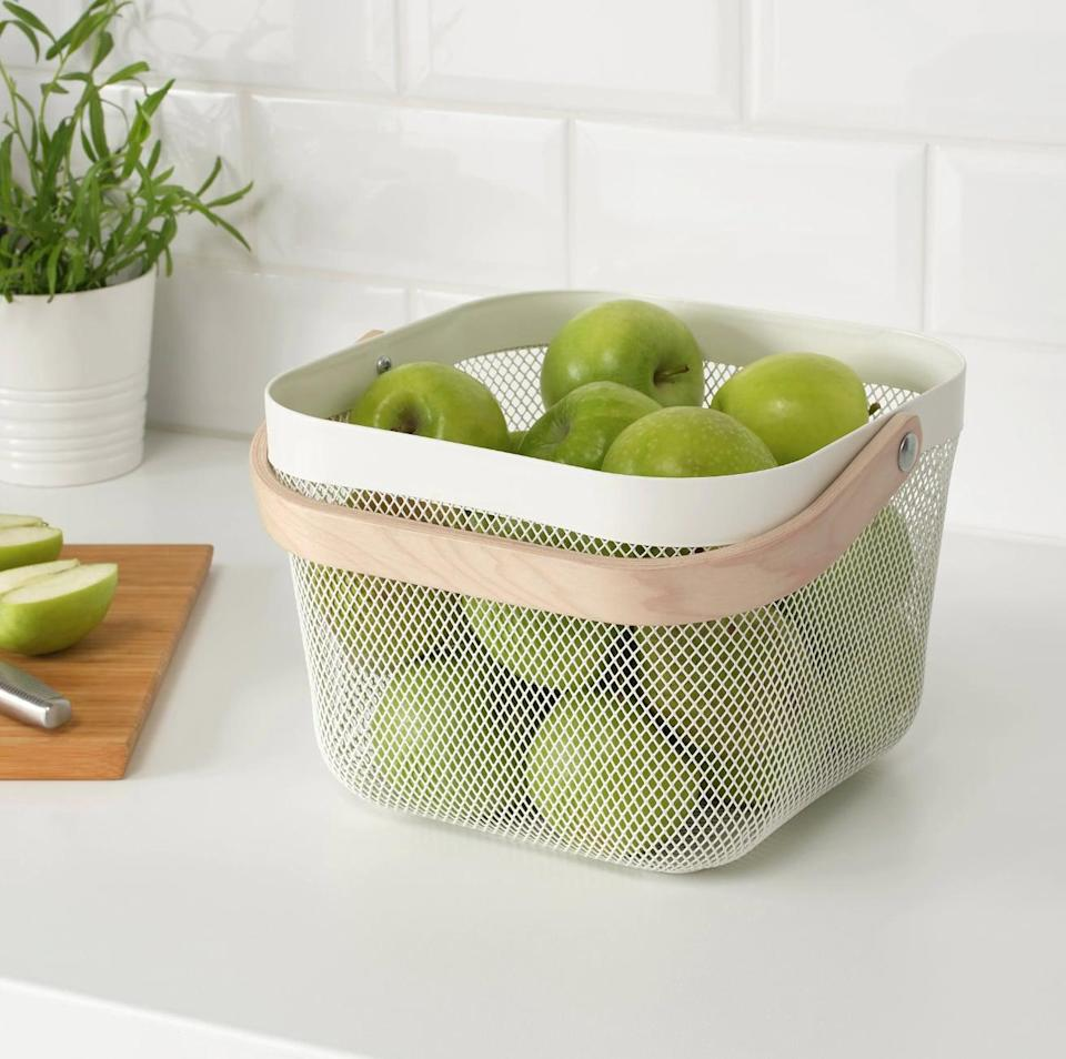 "<p>Great for fresh fruit and vegetables, the <a href=""https://www.popsugar.com/buy/Risatorp%20Wire%20Basket-446980?p_name=Risatorp%20Wire%20Basket&retailer=ikea.com&price=13&evar1=casa%3Aus&evar9=46151613&evar98=https%3A%2F%2Fwww.popsugar.com%2Fhome%2Fphoto-gallery%2F46151613%2Fimage%2F46152168%2FRisatorp-Wire-Basket&list1=shopping%2Cikea%2Corganization%2Ckitchens%2Chome%20shopping&prop13=api&pdata=1"" rel=""nofollow noopener"" target=""_blank"" data-ylk=""slk:Risatorp Wire Basket"" class=""link rapid-noclick-resp"">Risatorp Wire Basket</a> ($13) will keep your counter free of clutter.</p>"