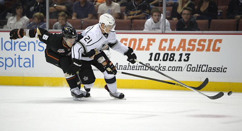Anaheim Ducks defenseman Ben Lovejoy, left, vies for the puck with Los Angeles Kings right wing Matt Frattin during the first period of a preseason NHL hockey game, Tuesday, Sept. 17, 2013, in Anaheim, Calif. (AP Photo/Mark J. Terrill)