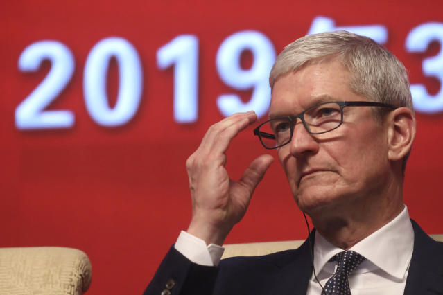 """Apple CEO Tim Cook reacts during the Economic Summit held for the China Development Forum in Beijing, China, Saturday, March 23, 2019. Cook says he's """"extremely bullish"""" about the global economy based on the amount of innovation being carried out, and he's urging China to continue to """"open up."""" (AP Photo/Ng Han Guan)"""
