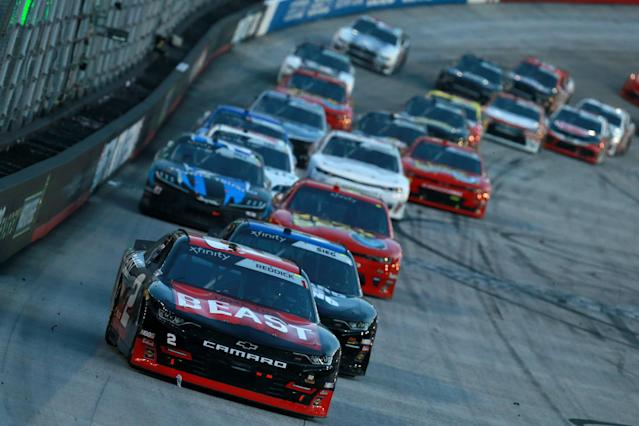 "<a class=""link rapid-noclick-resp"" href=""/nascar/truck/drivers/3384"" data-ylk=""slk:Tyler Reddick"">Tyler Reddick</a>, driver of the #2 Tame the BEAST Chevrolet, leads a pack of cars during the NASCAR Xfinity Series Food City 300 at Bristol Motor Speedway on Aug. 16, 2019 in Bristol, Tennessee. (Sean Gardner/Getty Images)"