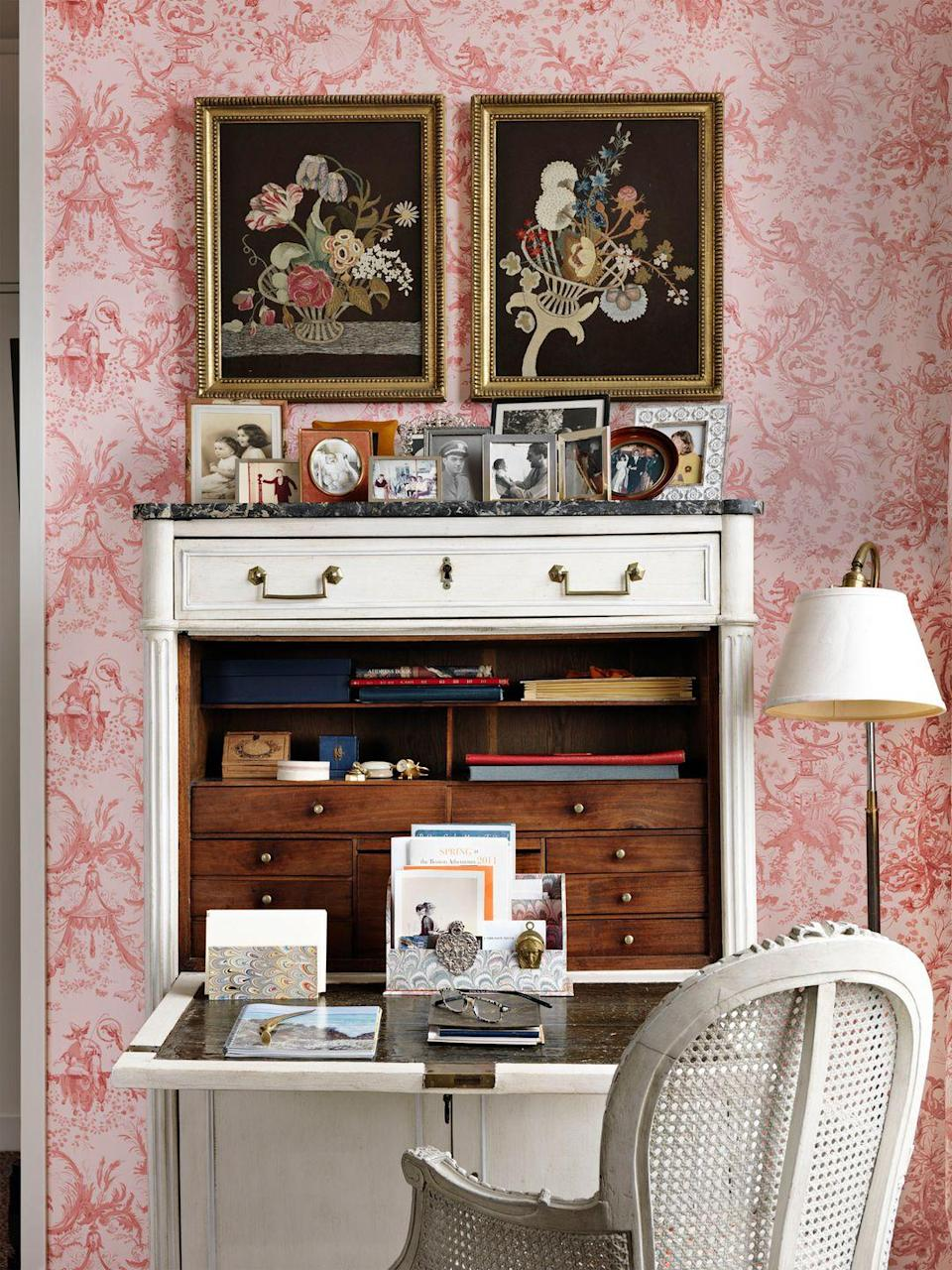 """<p>Keep your eyes peeled for a secretary desk to rehab at local antiques shops, vintage stores, estate sales, or flea markets. This one in a bedroom designed by <a href=""""https://www.libbycameron.com/"""" rel=""""nofollow noopener"""" target=""""_blank"""" data-ylk=""""slk:Libby Cameron"""" class=""""link rapid-noclick-resp"""">Libby Cameron</a> was refurbished with new paint, but you could also swap out the hardware or affix a thin marble slab to the top of it to add a personal touch. </p>"""