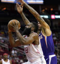 Houston Rockets' James Harden (13) goes up for a shot as Phoenix Suns' Kelly Oubre Jr. defends during the first half of an NBA basketball game Saturday, Dec. 7, 2019, in Houston. (AP Photo/David J. Phillip)