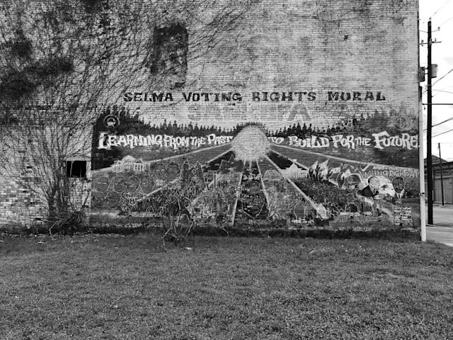 <p>A mural honoring Selma's history in the civil rights movement on the side of an abandoned building in downtown. (Photo: Holly Bailey/Yahoo News) </p>