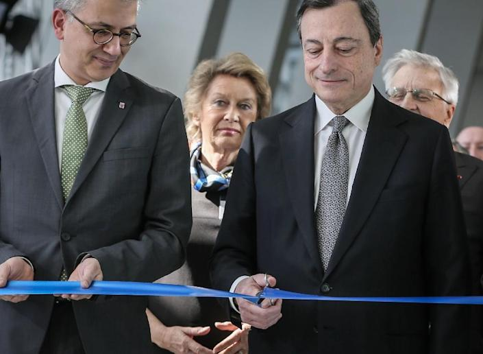 European Central Bank chief Mario Draghi cuts the ribbon during the official opening of the ECB's new headquarters in Frankfurt, on March 18, 2015 (AFP Photo/Frank Rumpenhorst)