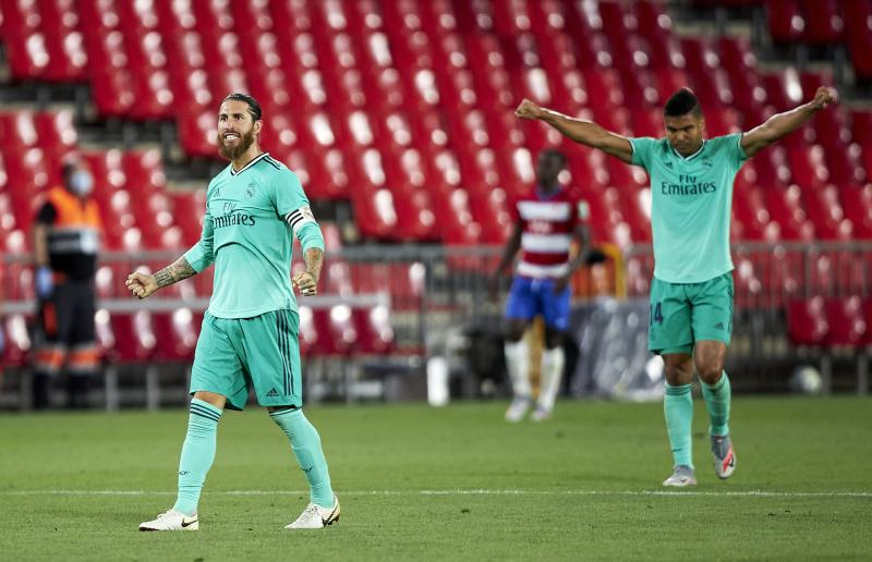 GRANADA, SPAIN - JULY 13: Sergio Ramos of Real Madrid celebrates after the Liga match between Granada CF and Real Madrid CF at Nuevo Los Carmenes on July 13, 2020 in Granada, Spain. Football Stadiums around Europe remain empty due to the Coronavirus Pandemic as Government social distancing laws prohibit fans inside venues resulting in all fixtures being played behind closed doors. (Photo by Fermin Rodriguez/Quality Sport Images/Getty Images)