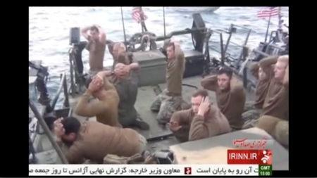 U.S. sailors are pictured on a boat with their hands on their heads at an unknown location.  REUTERS/IRINN via Reuters TV