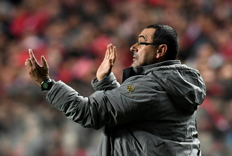 Napoli's coach Maurizio Sarri gestures from the sideline during the UEFA Champions League Group B football match SL Benfica vs SSC Napoli at the Luz stadium in Lisbon, on December 6, 2016