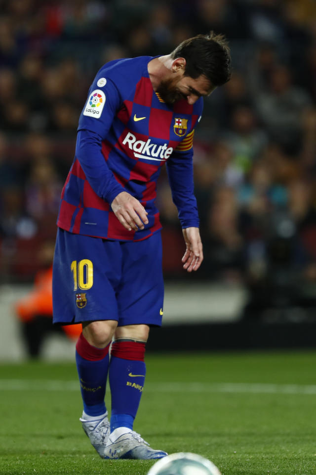 Barcelona's Lionel Messi reacts after a missed scoring opportunity during a Spanish La Liga soccer match between Barcelona and Real Sociedad at the Camp Nou stadium in Barcelona, Spain, Saturday, March 7, 2020. (AP Photo/Joan Monfort)