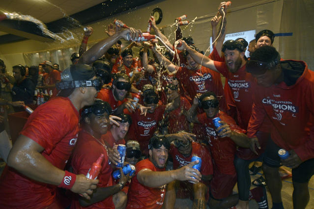 The Washington Nationals celebrate in the locker room after they clinched the National League East title after a baseball game against the Philadelphia Phillies, Sunday, Sept. 10, 2017, in Washington. (AP Photo/Nick Wass)