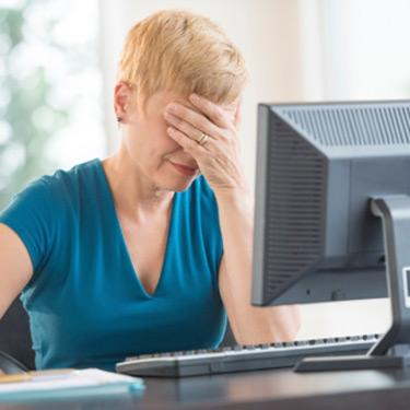Tired-older-businesswoman-leaning-on-hand_web